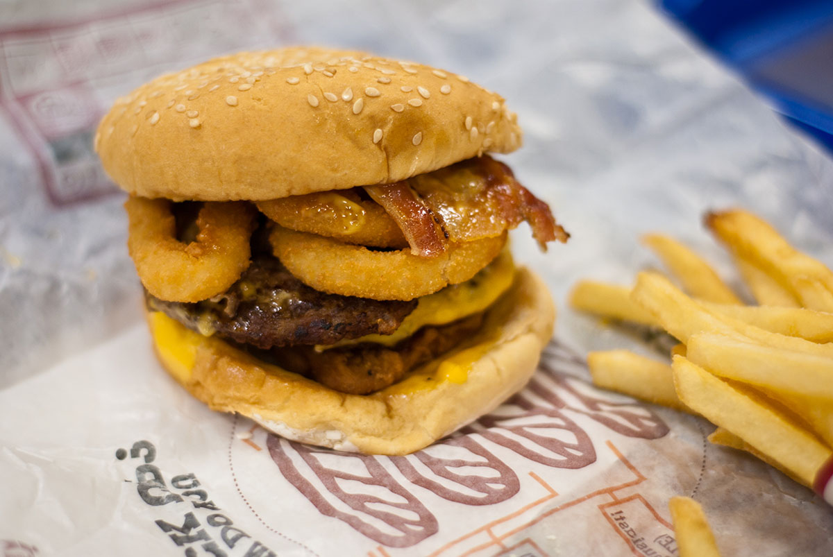 I noticed a trend in fast food restaurants nowadays - they just keep adding crap in the burger, then selling it for 2x it's regular price saying it's something new. So I figured I'd beat them to the punch this time; I ordered onion rings, nuggets, a bacon double stack and went to town. Oh, and I asked for a side of spicy mayo which I mixed with some ketchup and mayo, as the 'new special sauce'.