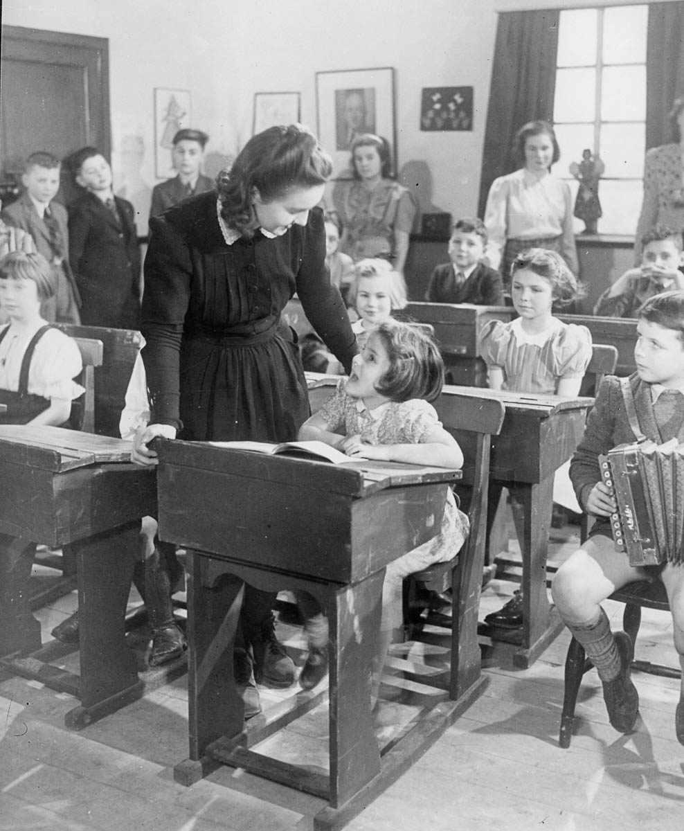 circa 1935: A little girl at a Czech school obviously enjoys her lesson. (Photo by General Photographic Agency/Getty Images)