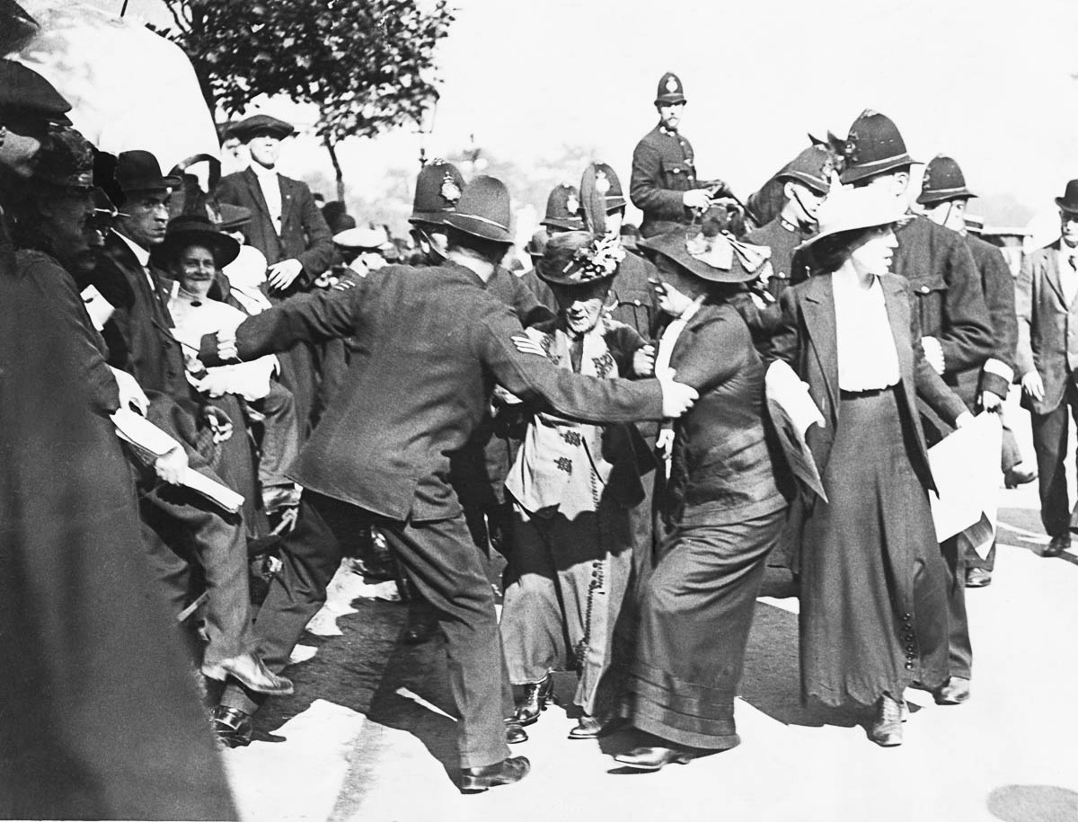 Police prevent suffragist Emmeline Pankhurst and her two daughters (left to right) Chistabel and Sylvia from entering Buckingham Palace to present a petition to the King.